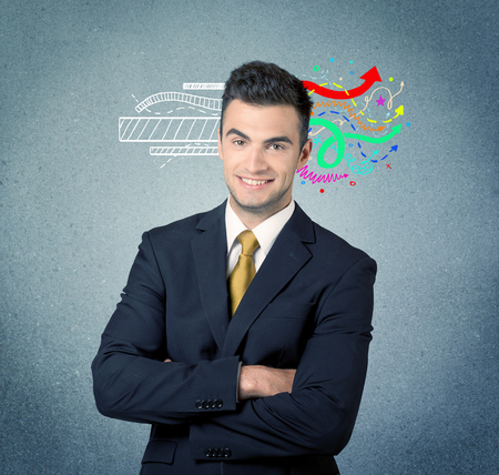 sales person: A handsome sales person standing in front of a blue  urban concrete wall with illustration expressing creativity by transforming white lines to colorful arrows cocncept