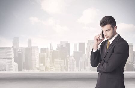 young adult: A young adult businessman standing in front of city landscape with skyscraper buildings and clouds concept