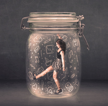 suffocating: Business woman captured in glass jar with hand drawn media icons concept on background