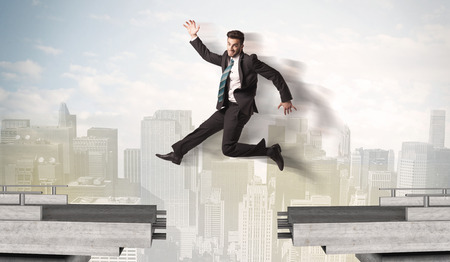bridge the gap: Energetic business man jumping over a bridge with gap concept Stock Photo