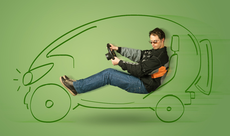 concept car: Man drives an eco friendy electric hand drawn car concept