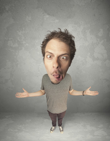 exaggeration: Funny person with big head on gray background