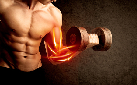 nude male body: Fit bodybuilder lifting weight with red muscle concept on background