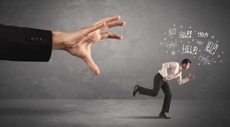 away: Business person running away from big hand while asking for help concept on background