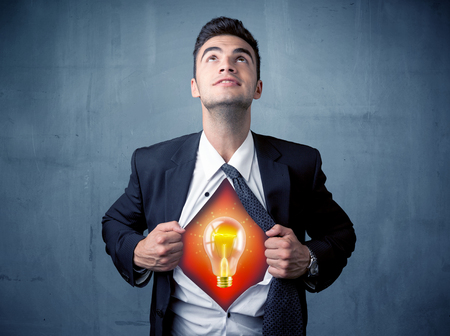 ripping shirt: Businessman ripping off shirt and idea light bulb appears on his chest concept on backround
