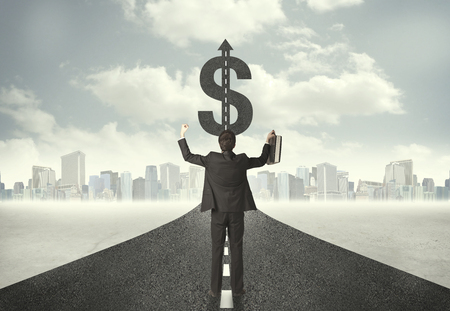 dollar signs: Business man on road heading toward a dollar sign concept