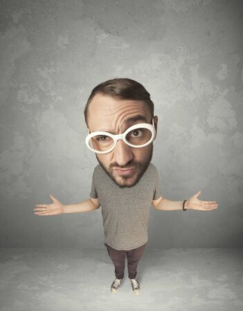 merriment: Funny person with big head on gray background