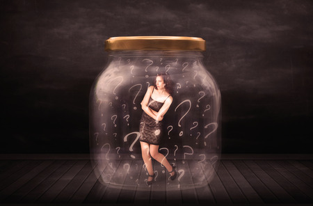 suffocating: Businesswoman locked into a jar with question marks concept on background Stock Photo