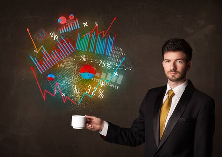 creative force: Businessman standing and holding a white cup with diagrams and graphs coming out of the cup Stock Photo