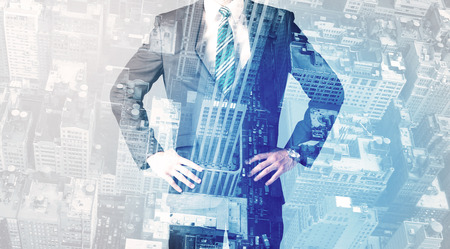 city of sunrise: Business person standing with blue cityscape in the background Stock Photo