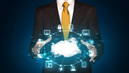 cloud computer: Businessman holding digital icons, Cloud computing concept
