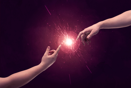 woman arms up: White caucasian male hands reaching out with fingers almost touching in bright red light sparkle in empty space background concept