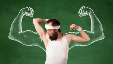 imagining: A young male with beard and glasses posing in front of green background, imagining how he would look like with big muscles, illustrated by white drawing concept.