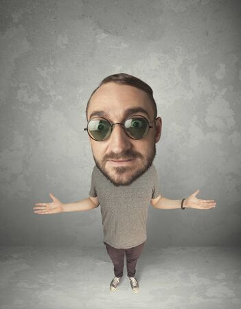 gladness: Funny person with big head on gray background