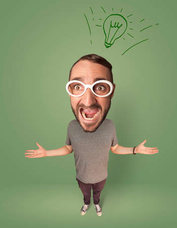 gladness: Funny person with big head and drawn idea bulb over it