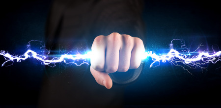 rayo electrico: Business man holding electricity light bolt in his hands concept