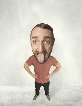 jesting: Funny person with big head makes jesting facial expression Stock Photo