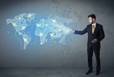 EUROPE MAP: Business person showing digital blue map with planes around the world concept