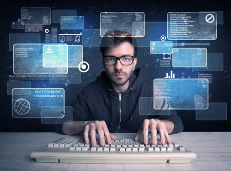 obsessive: A confident young hacker working hard on solving online password codes concept with a computer keyboard and illustrated digital screen, numbers in the background Stock Photo