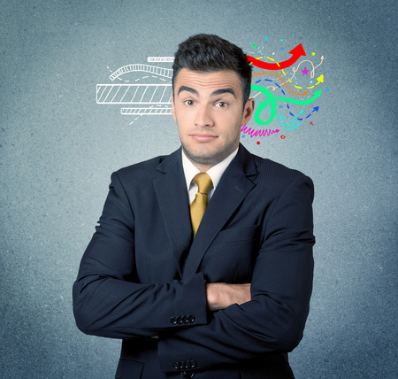 transforming: A handsome sales person standing in front of a blue  urban concrete wall with illustration expressing creativity by transforming white lines to colorful arrows cocncept