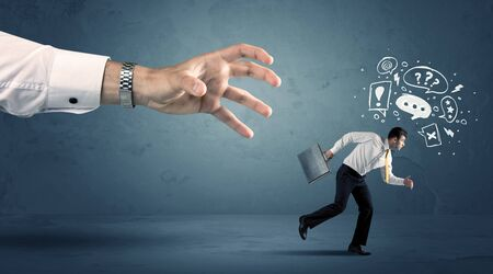 business performance: Business man with doodle icons running from a big hand concept on background