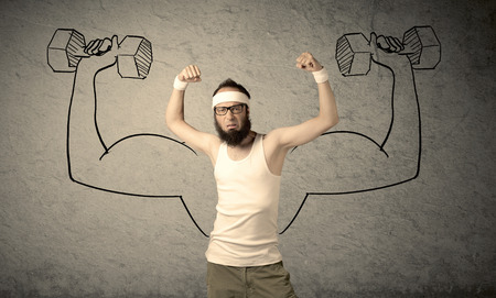 skinny: A young college student with beard and glasses posing in front of grey background, thinking about lifting weight with big muscles, illustrated by white drawing concept.