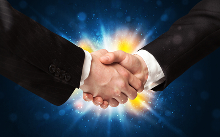 career job: Two business men shaking hands with a successes agreement with explosion