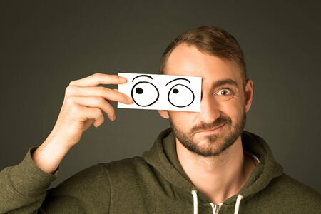 silly: Silly man looking with hand drawn eye balls on paper Stock Photo