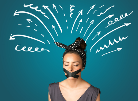 keep an eye on: Young woman with taped mouth and white drawn lines and arrows around her head
