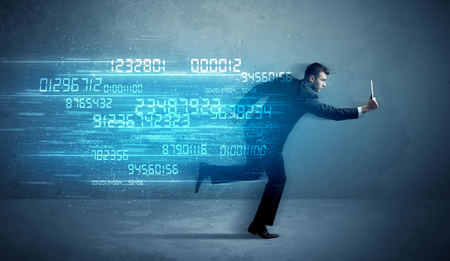 wireless data: Business man running with media device and high tech wireless data concept on background Stock Photo