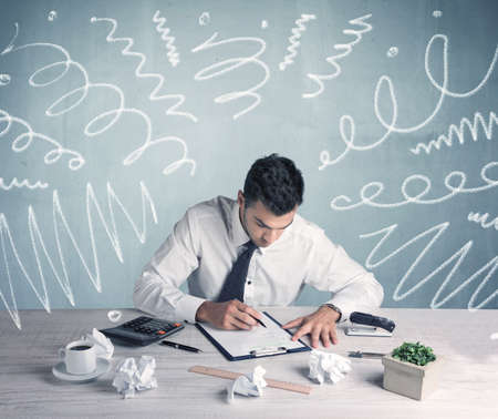 bad planning: An elegant businessman sitting at office desk and working on keyboard with drawn curves, lines illustration on background wall concept