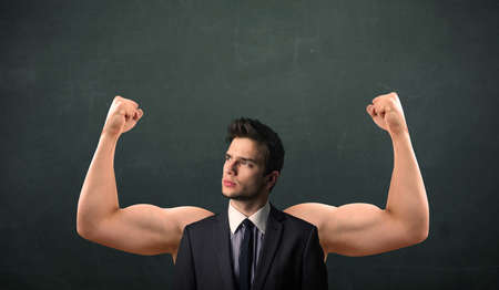 muscled: Young businessman wondering with strong and muscled arms concept