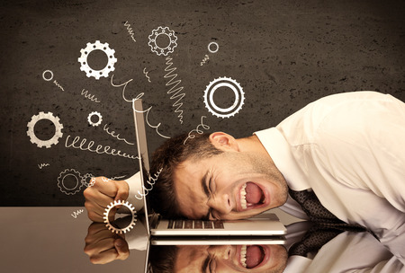 Falling apart illustration concept with cranks, cog wheels springing from a fed up and tired businessman's head resting on laptop keyboard Banco de Imagens