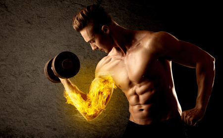 lifting: Muscular bodybuilder lifting weight with flaming biceps concept on background