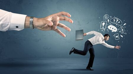 work worker: Business man with doodle icons running from a big hand concept on background
