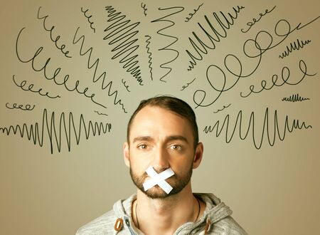 sellotape: Young man with taped mouth and curly lines around his head Stock Photo