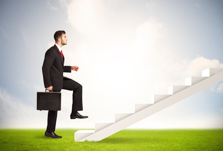 stairway: Business person climbing up on white staircase in nature background concept Stock Photo