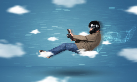 speed car: Funny racedriver young man driving between clouds concept on blue background