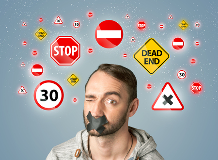 sellotape: Young man with taped mouth and traffic signals around his head