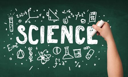 green chemistry: A teacher writing science, drawing chemistry elements on clean green chalkboard by hand
