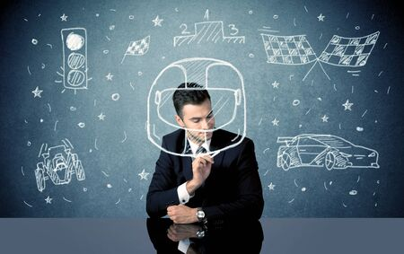 concept car: A happy businessman sitting at desk and drawing race car, flag, helmet around himself with a white chalk concept