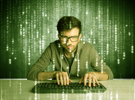 geek: A talented hacker scanning online passwords database and hacking emails of users with numbers, codes, letters running in the background concept Stock Photo
