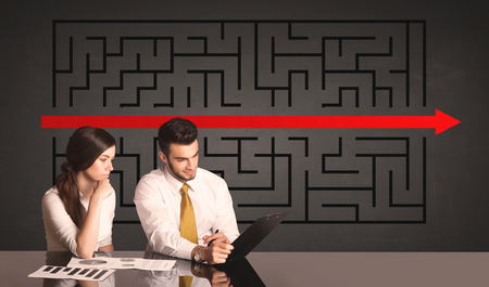complicated journey: Successful business couple with a solved puzzle in background Stock Photo