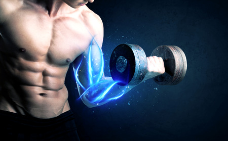 Fit athlete lifting weight with blue muscle light concept on background