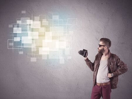 the guy: A funny stylish hipster guy capturing bright moments and glowing square pictures with a vintage photo camera illustration concept