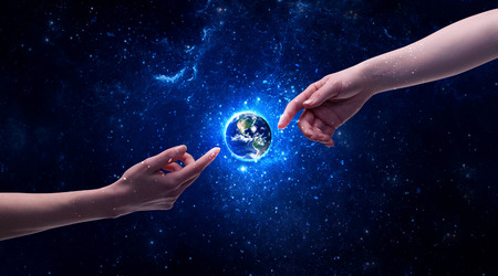 mature men: Male god hands about to touch the earth globe in the galaxy with bright shining stars and blue light illustration concept. Elements of this image furnished by NASA.