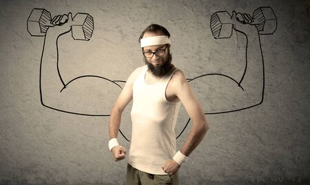 thinking student: A young college student with beard and glasses posing in front of grey background, thinking about lifting weight with big muscles, illustrated by white drawing concept.
