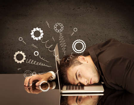 hand crank: Falling apart illustration concept with cranks, cog wheels springing from a fed up and tired businessmans head resting on laptop keyboard Stock Photo