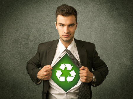 tearing: Enviromentalist business man tearing off shirt with recycle sign on his chest concept on backround