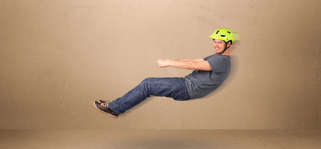 flying man: Happy funny man driving a flying car concept on background Stock Photo